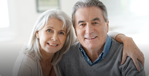 Mature Woman and Man Smiling