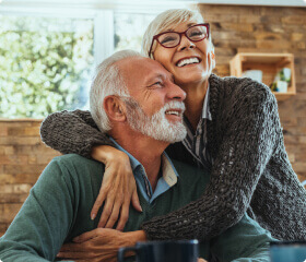 Older Woman and Man Embracing