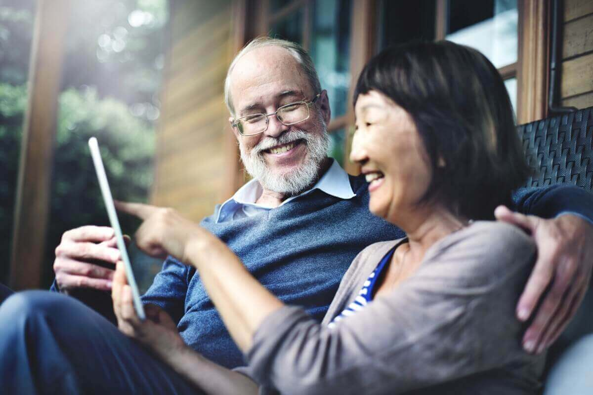 Mature Couple Looking at a Tablet Computer
