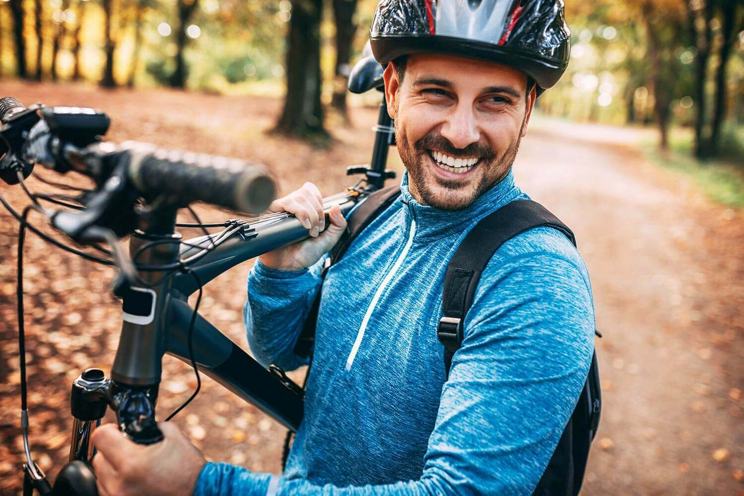 Smiling Man Carrying a Bike