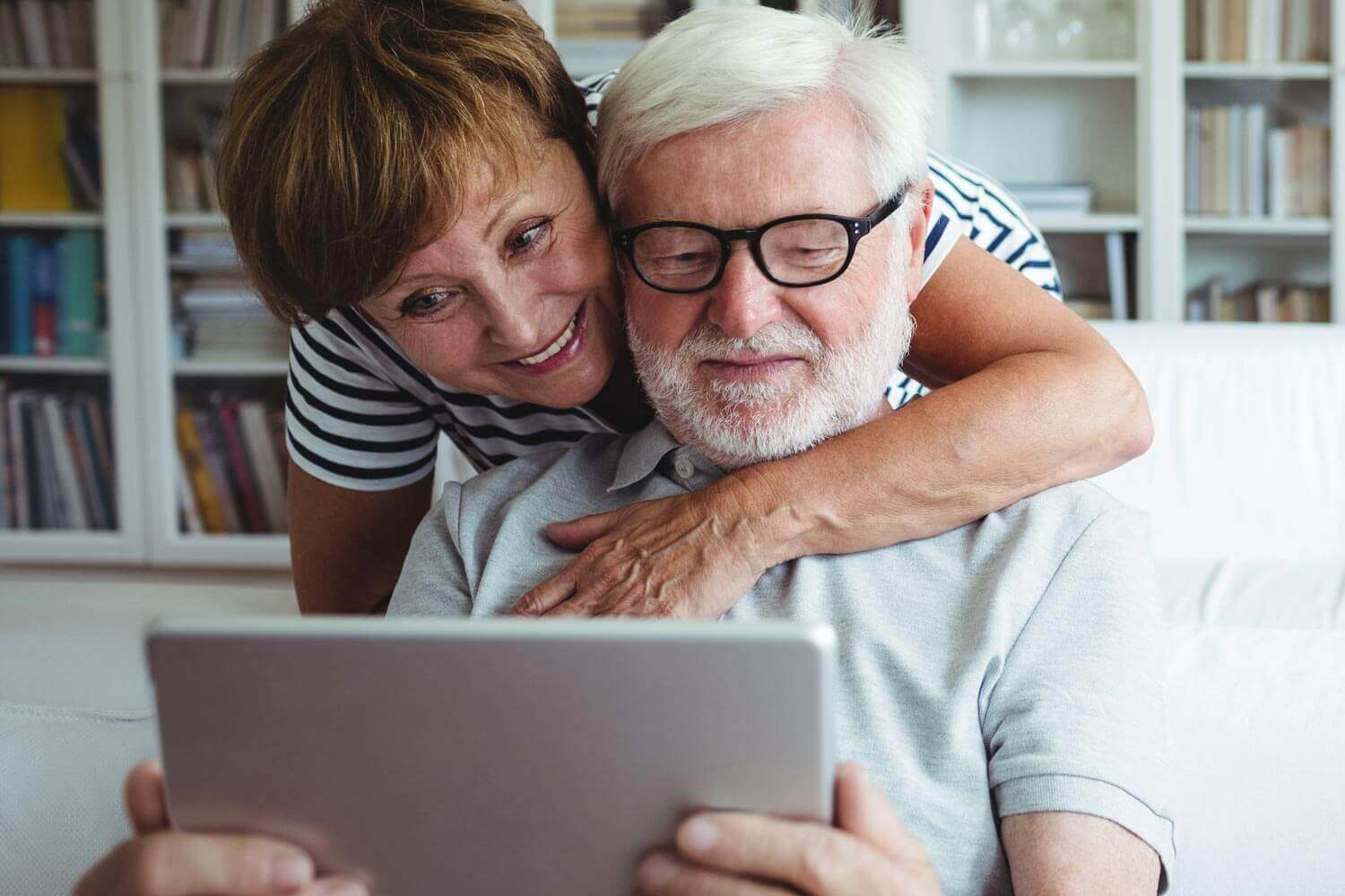 Older Woman and Man Looking a Tablet Computer